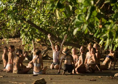 Danyasa yoga training students celebrating on the beach in Costa Rica