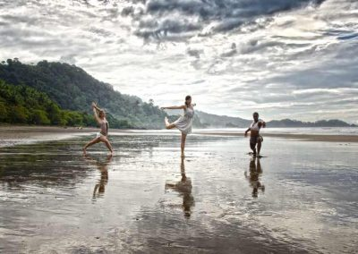 Danyasa retreat leaders doing yoga on the beach in Dominical Costa Rica