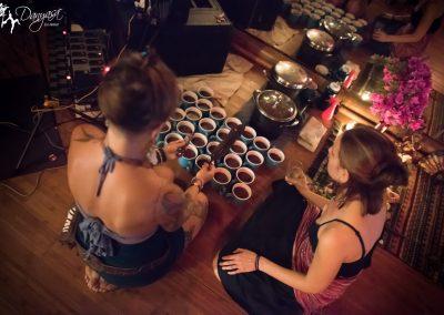 ladies pouring cacao elixir pre-ceremony