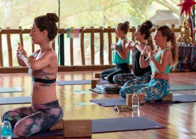 yoga teacher training women doing asana in studio