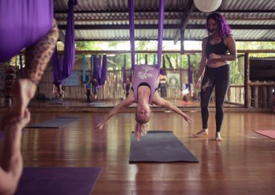 woman doing backbend in aerial yoga swing