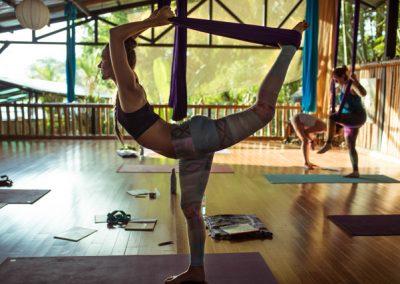 sofiah thom stretching in aerial yoga hammock in Danyasa studio