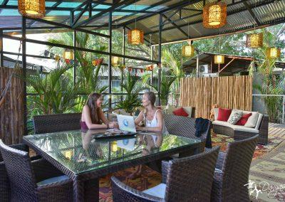 women chatting in communal dining area at Danyasa Retreat