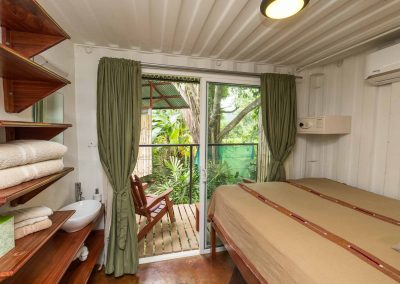 Photo of a Superior Queen Room at Danyasa Eco-Retreat with private sink, A/C, beautiful built in shelving, and a private patio